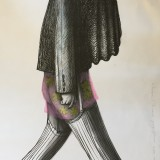 Markus Kasemaa-Kaetud peaga figuur sukkades